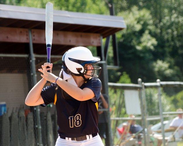 Teen girl playing softball in organized game