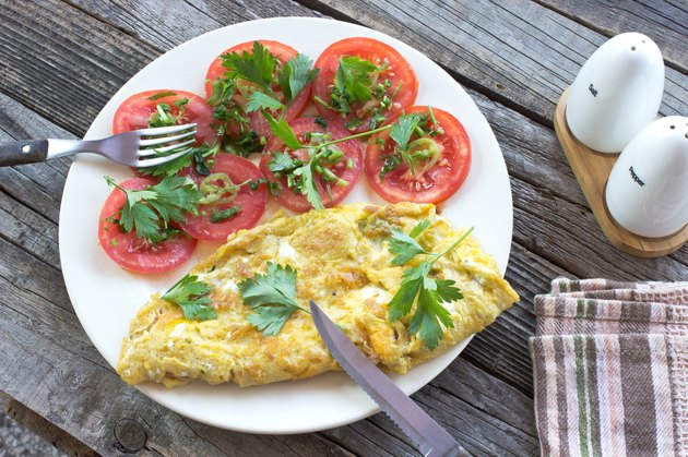 Omelette fried eggs with vegetables
