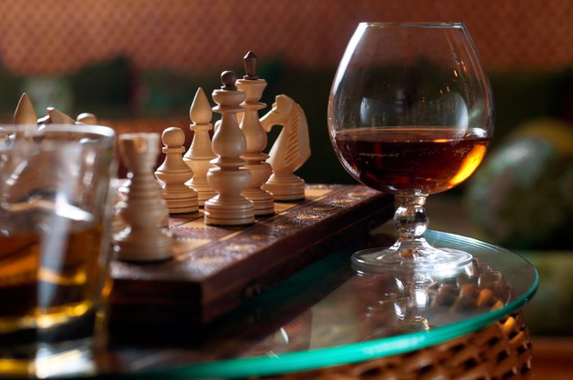 Chess-board and a glass of wine