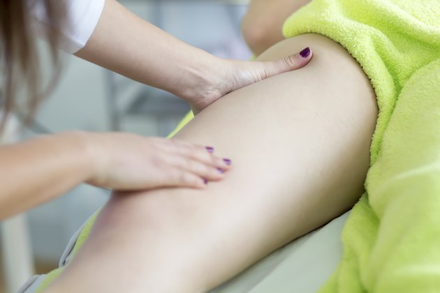 Lymph leg drainage massage with hands in a beauty salon