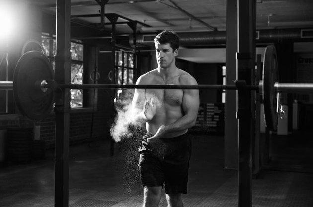 Black And White Shot Of Man Preparing To Lift Weights