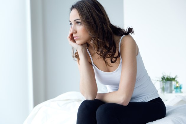 Young woman suffering from insomnia in the bed.
