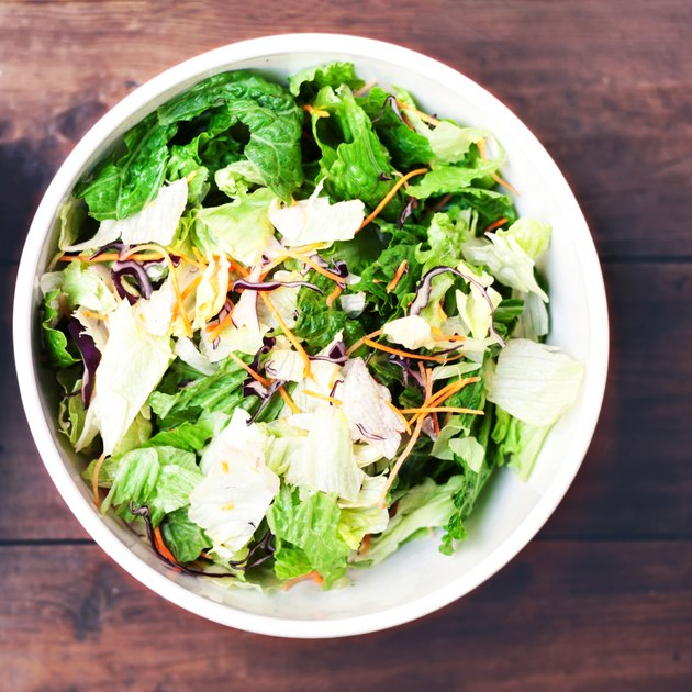 Fresh spring salad with rucola, red onion and lettuce