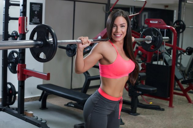 fitness woman lifting weight in gym