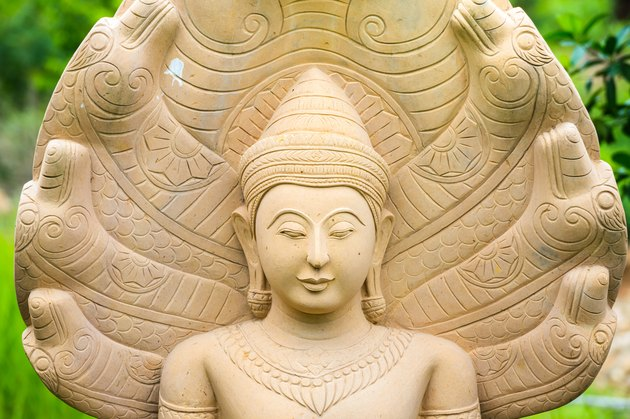 Buddha statues with a naga over His head