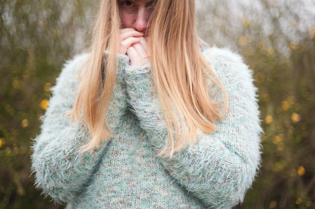 Blonde woman wearing fluffy jumper
