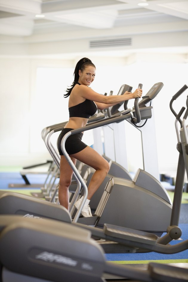 Woman exercising at health club