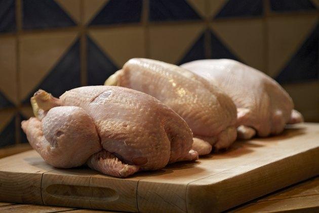 Uncooked chickens in kitchen
