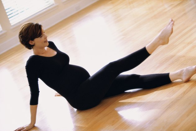 Pregnant young woman exercising