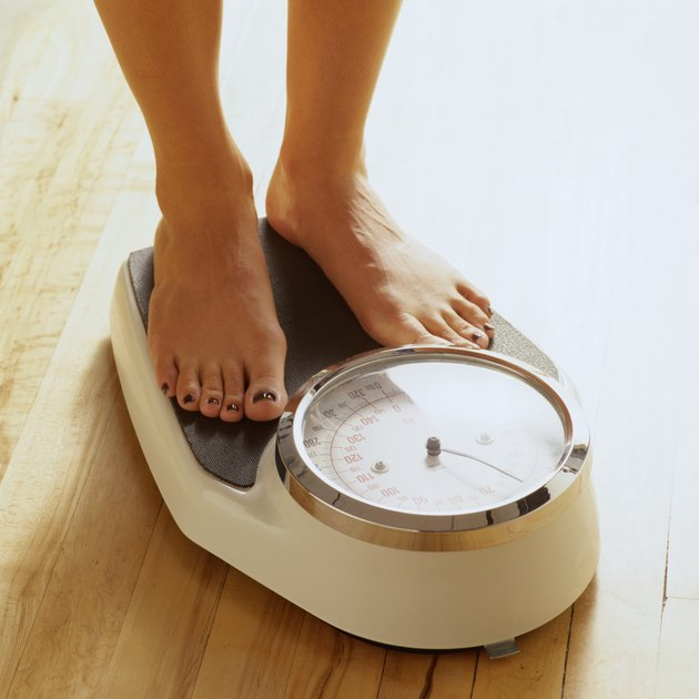 Woman's Feet on a Bathroom Scale