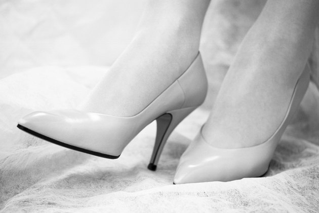 Photography of womans feet with high heels on, Close Up, Side View, Black and White