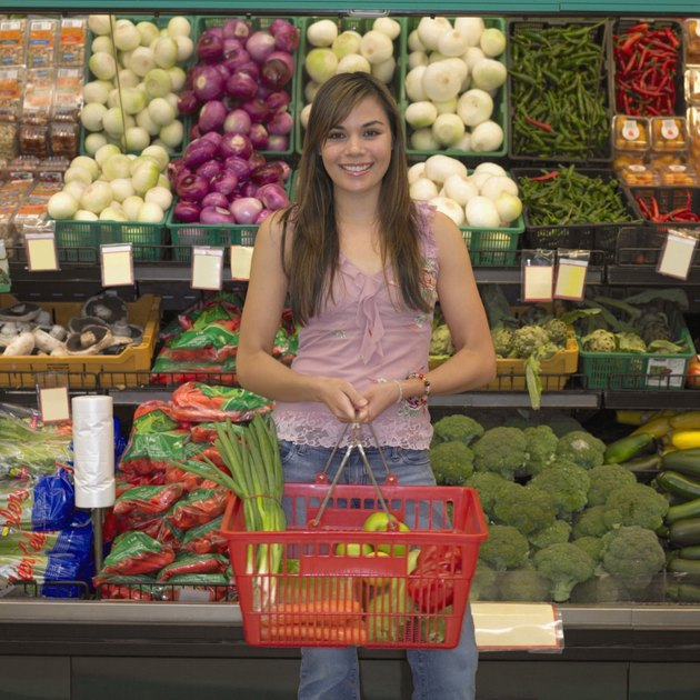 Young woman in produce section of supermarket