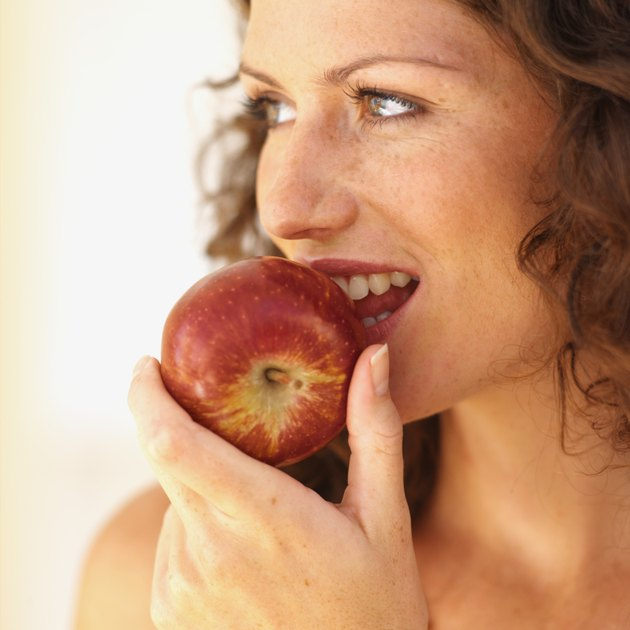 Close-up of a woman eating an apple