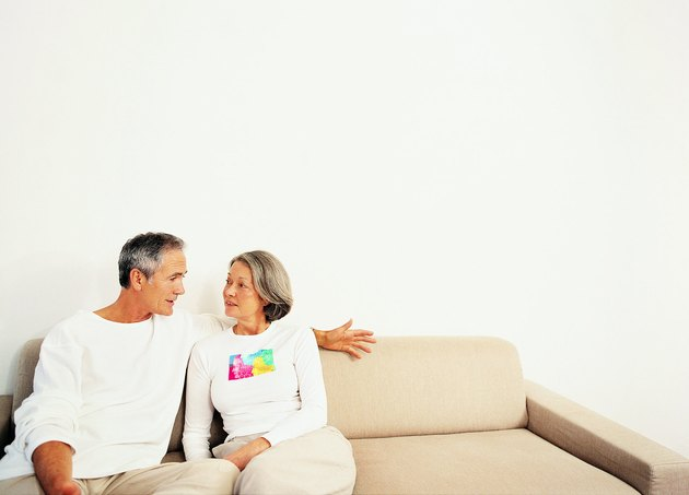 Mature Couple Talking on a Sofa