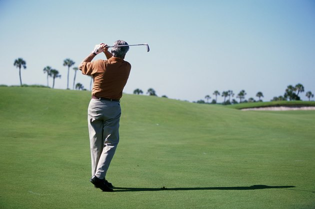 Rear view of a man playing golf