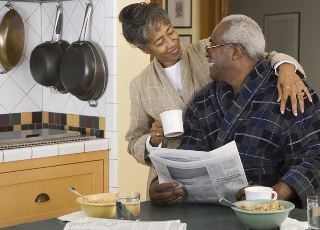Senior African couple at breakfast table