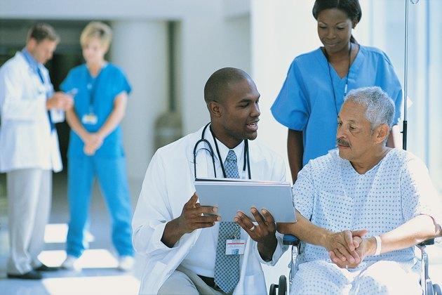 Patient in wheelchair with doctors