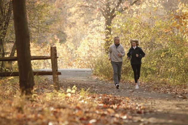 Couple jogging on scenic autumn path