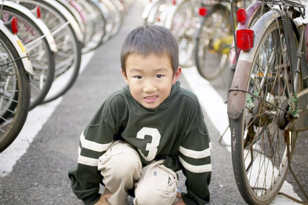 Smiling boy by bicycles