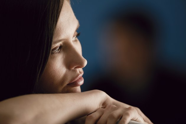 Profile of worried woman