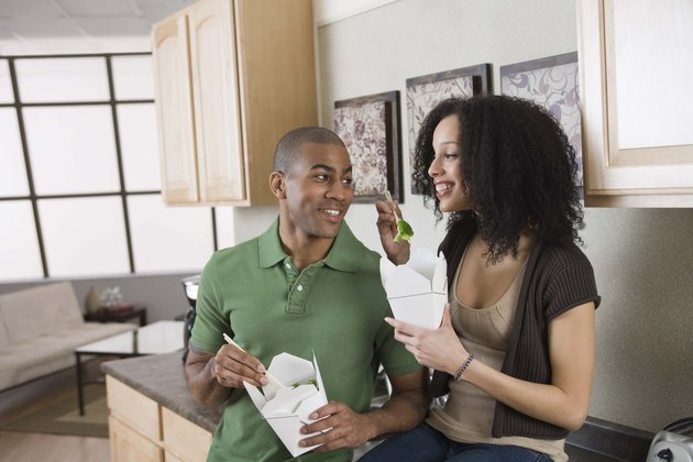 Couple eating Chinese food at home