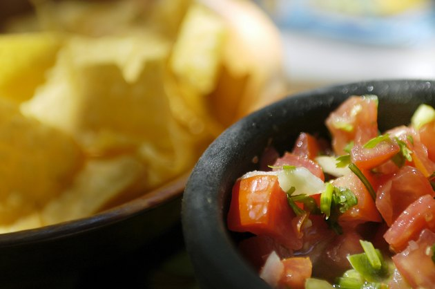 Bowl of salsa and tortilla chips at Mexican Restaurant