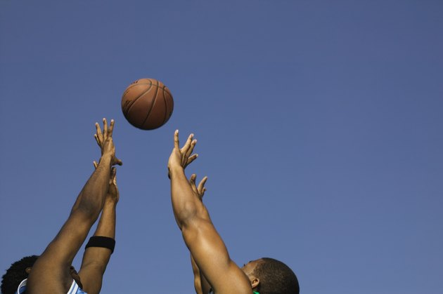 Basketball players competing for the ball