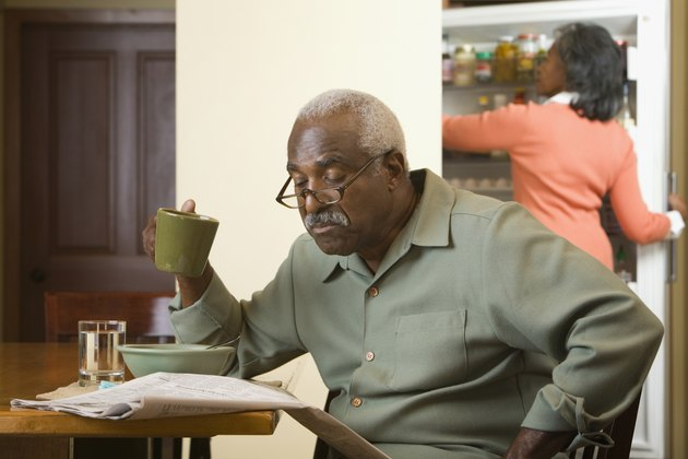 Senior African man reading newspaper
