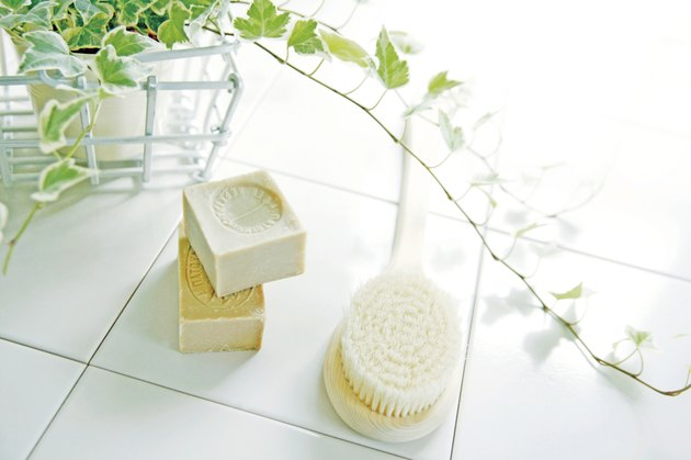 Body brush and soap in bathroom