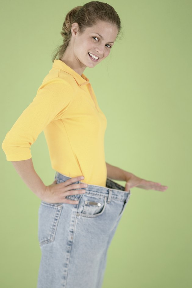 Woman wearing pants that are too big for her