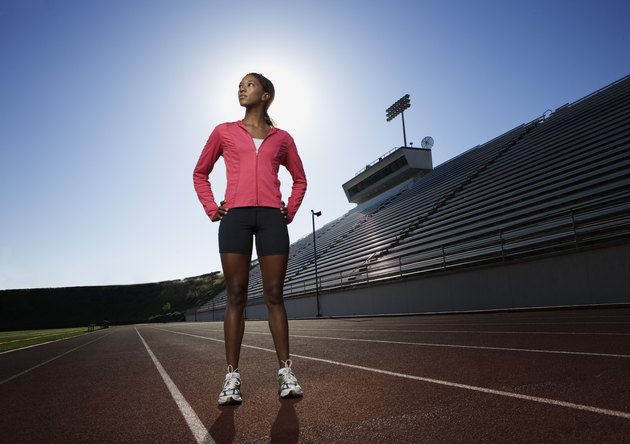 Woman standing on athletic track