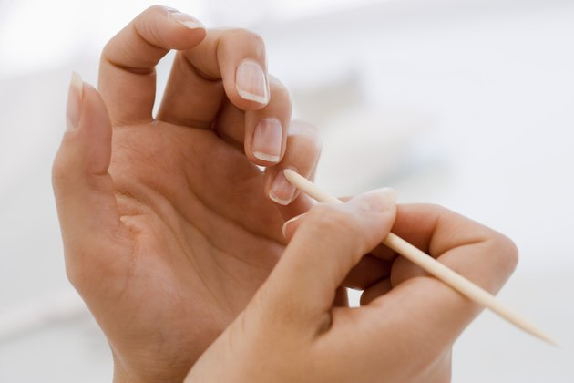 Pushing cuticle of fingernail