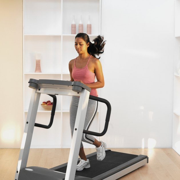 Woman running on a treadmill at home