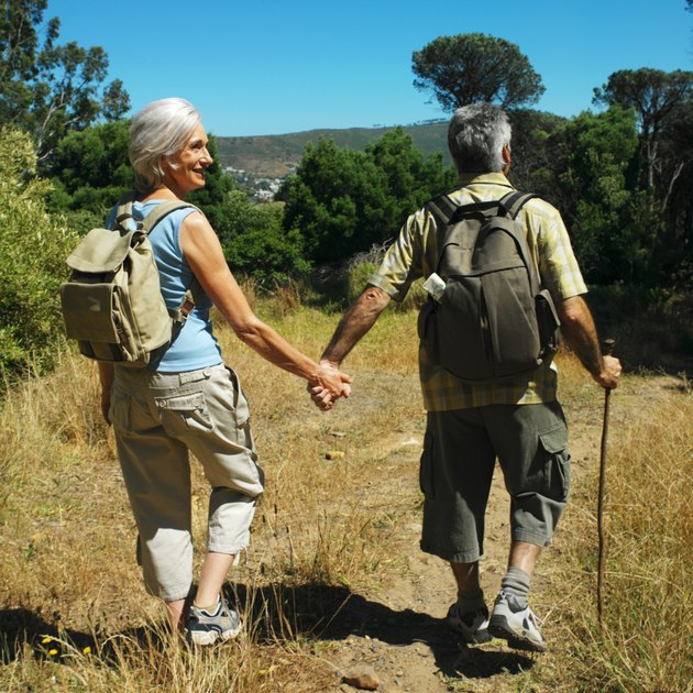 rear view of a mature couple out hiking in the wilderness