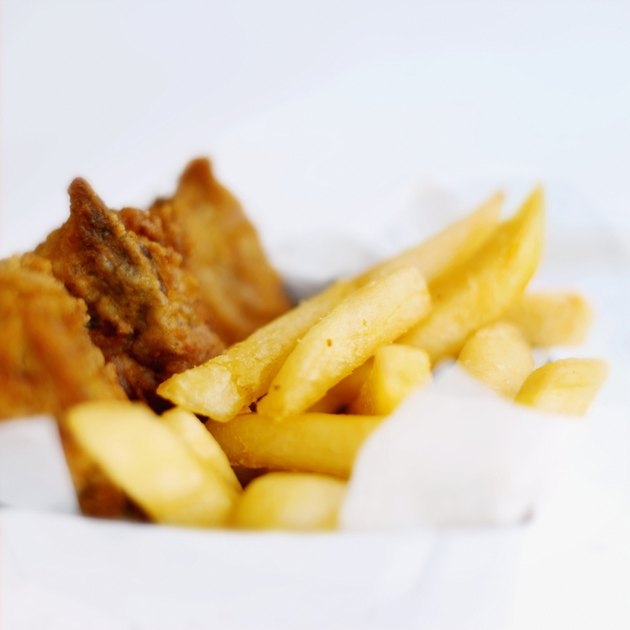 Close-up of a carton of french-fries and chicken