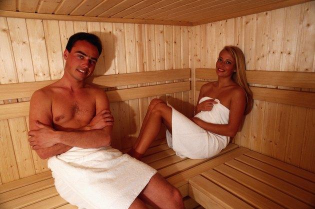 Couple sitting in sauna