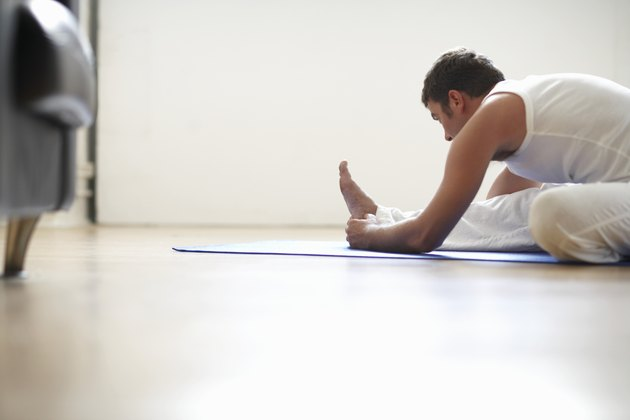 Man sitting in janu sirsasana position