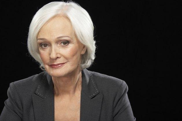 Senior businesswoman smiling, portrait, close-up