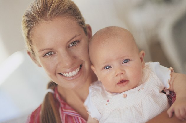 Portrait of a Young Mother Holding Her Newborn Baby