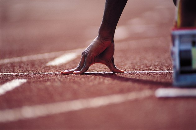 Hand of runner at starting blocks