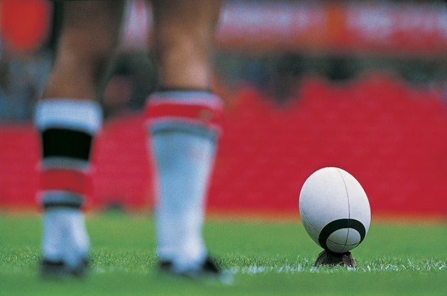 Rugby Player Preparing to Kick Ball