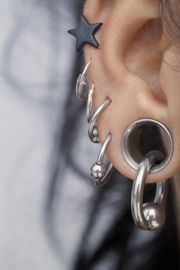 Close-up of a pierced female ear lobe