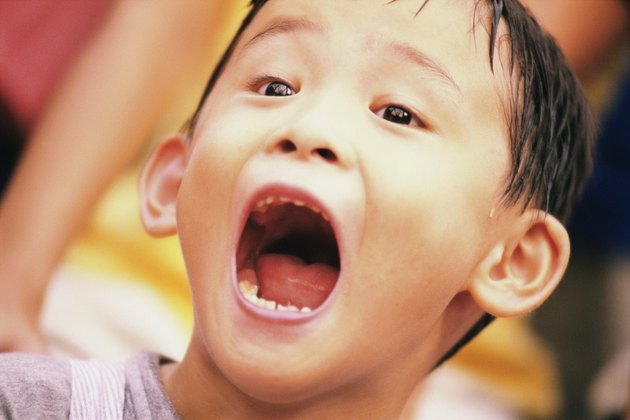 Close-up of a boy with his mouth open
