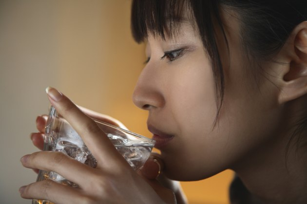 Close-up of Young Woman Drinking Water
