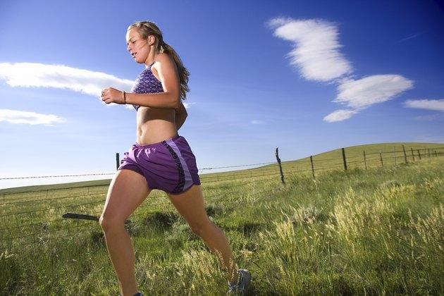 Woman running through field
