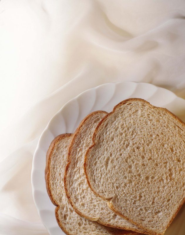 Slices of bread on paper plate