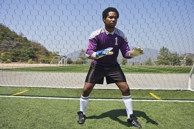 Soccer goalkeeper ready at goal