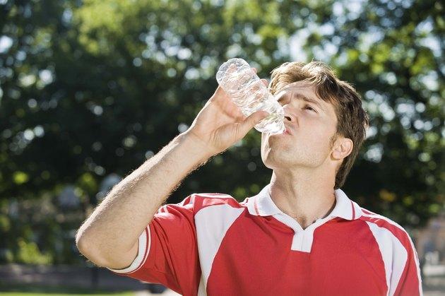 Soccer player drinking bottled water