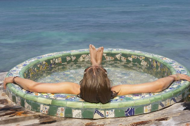 Young woman relaxing in a hot tub