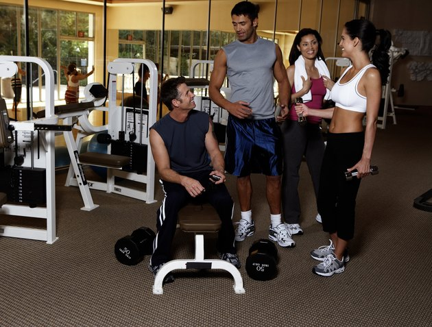 Men and women discussing in gym